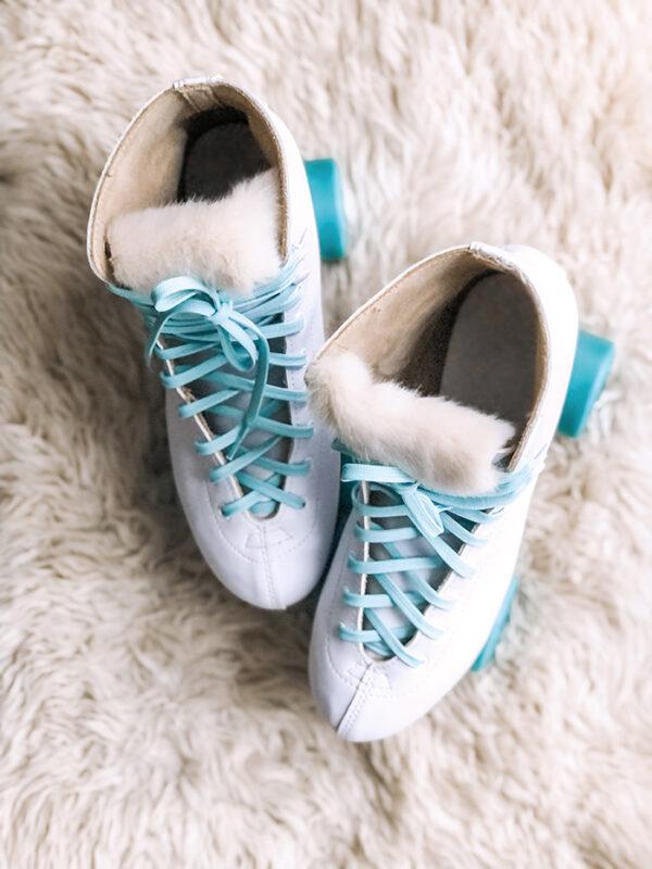 retro white skates with fur tongue-aqua laces and teal wheels