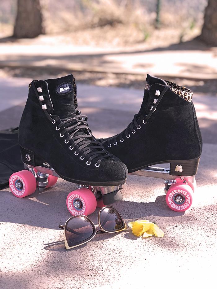 black suede roller skates with pink wheels, black moxi panthers, panthers, moxi roller skates, fritzys roller skate shop
