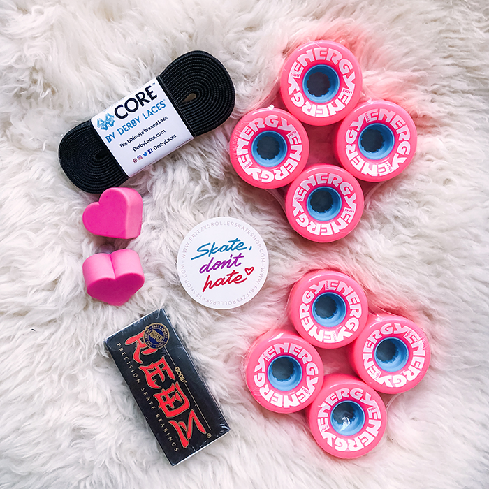 roller skate accessories, energy radar wheels, heart toe stops, derby laces, black suede roller skates with pink wheels, black moxi panthers, panthers, roller skates