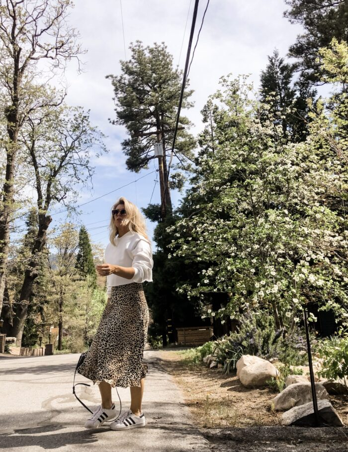 spring style, leopard slip dress with cropped sweatshirt and adidas sneakers, lake arrowhead, dogwood trees blooming, lake arrowhead, spring outfits, dresses with sneakers