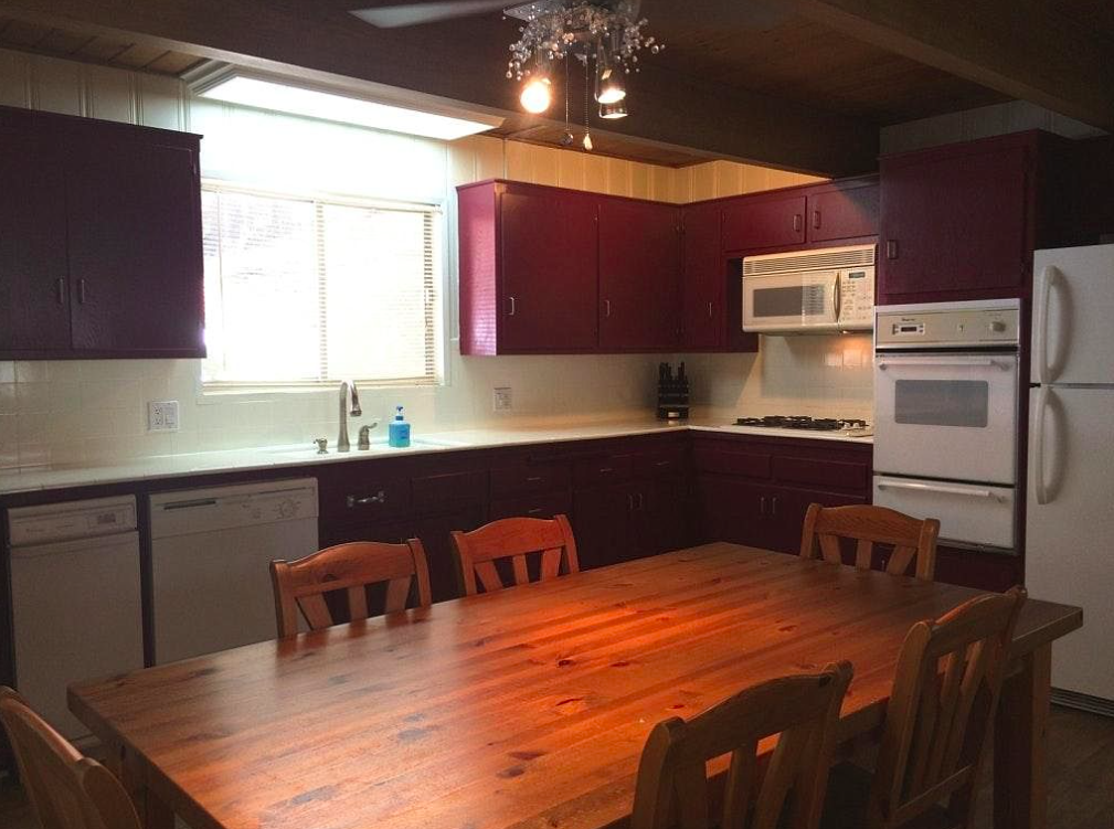 old small kitchen before with burgundy cabinets