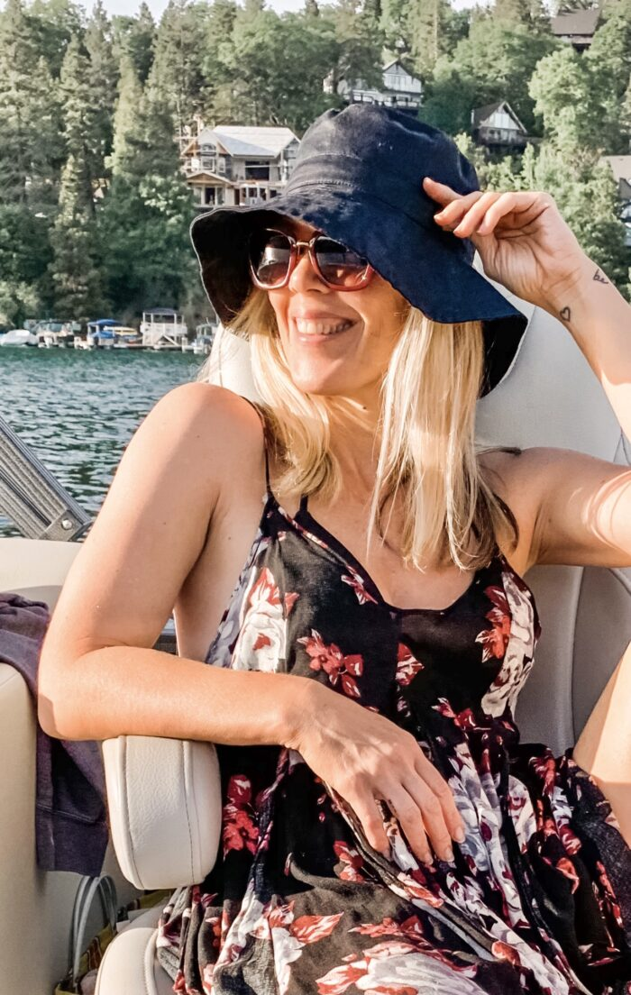 floral sun dress with bucket hat on the boat in lake arrowhead