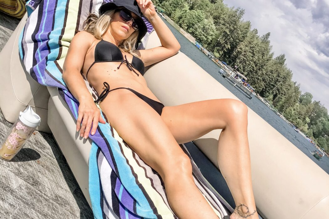 black bikini triangle top on a boat in lake arrowhead, lake life