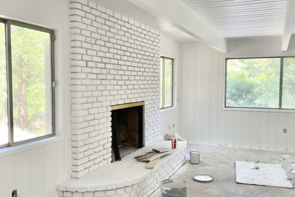 painted white interior, painted brick fireplace mantel, 60s lake house in lake arrowhead, z painting