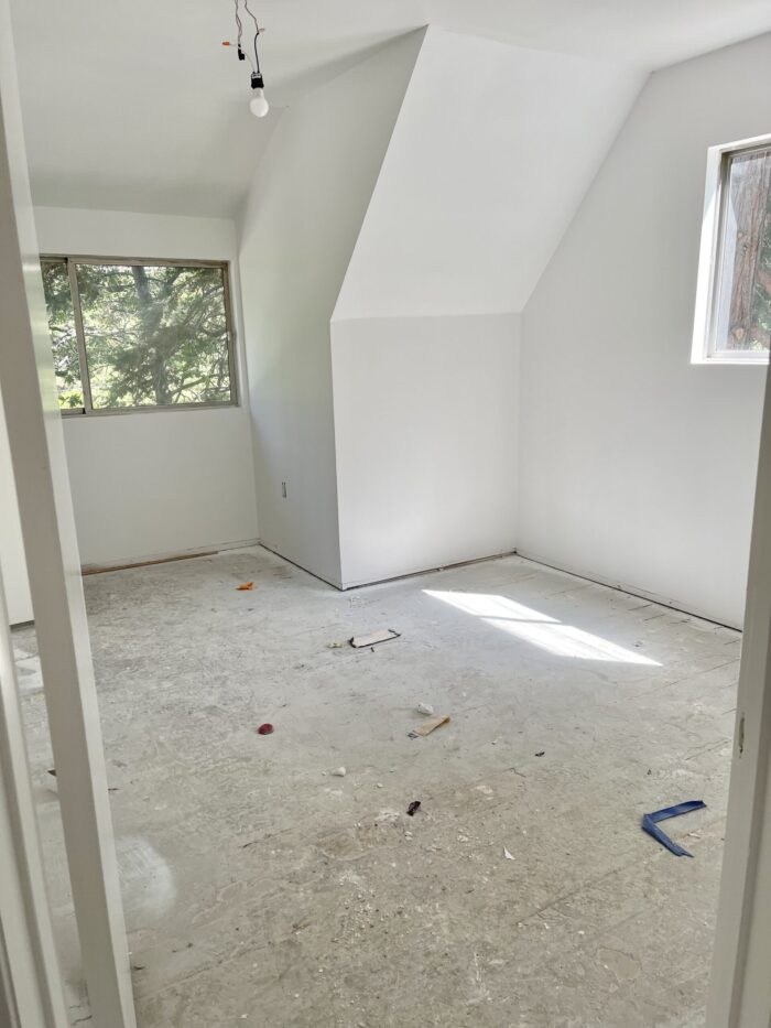 painted white interior, painted brick fireplace mantel, 60s lake house in lake arrowhead