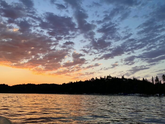 pink sunset on the water over the lake in lake arrowhead