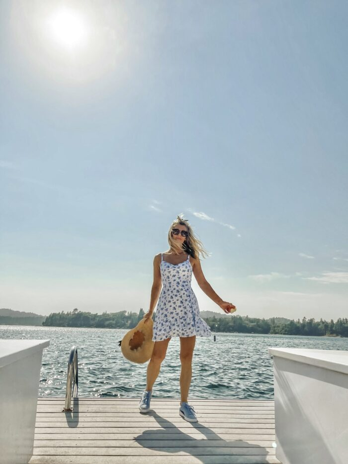 white sundress with blue flowers, on the lake, lake arrowhead, water, seascape, lakes in california, lakes near los angeles, summer style, lake life, lake dress, on a dock, boat life, docks in lake arrowhead, summer fashion