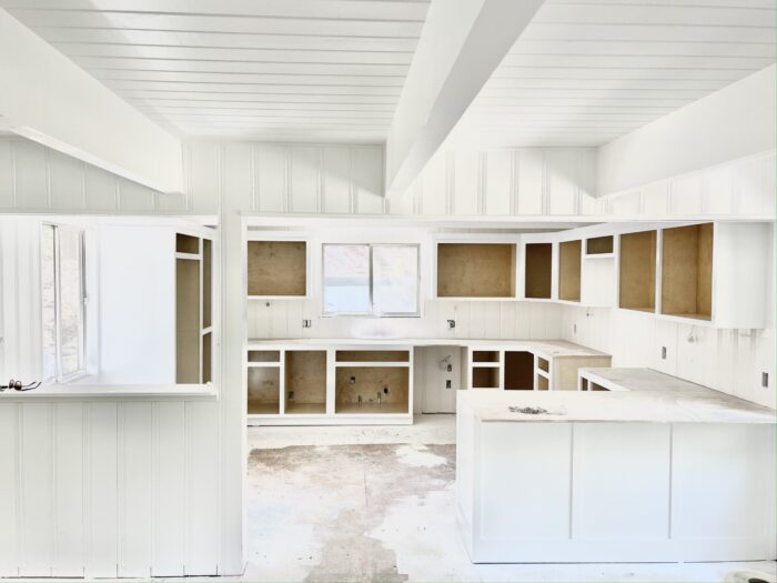 all white kitchen renovation cabinets with peninsula instead of island