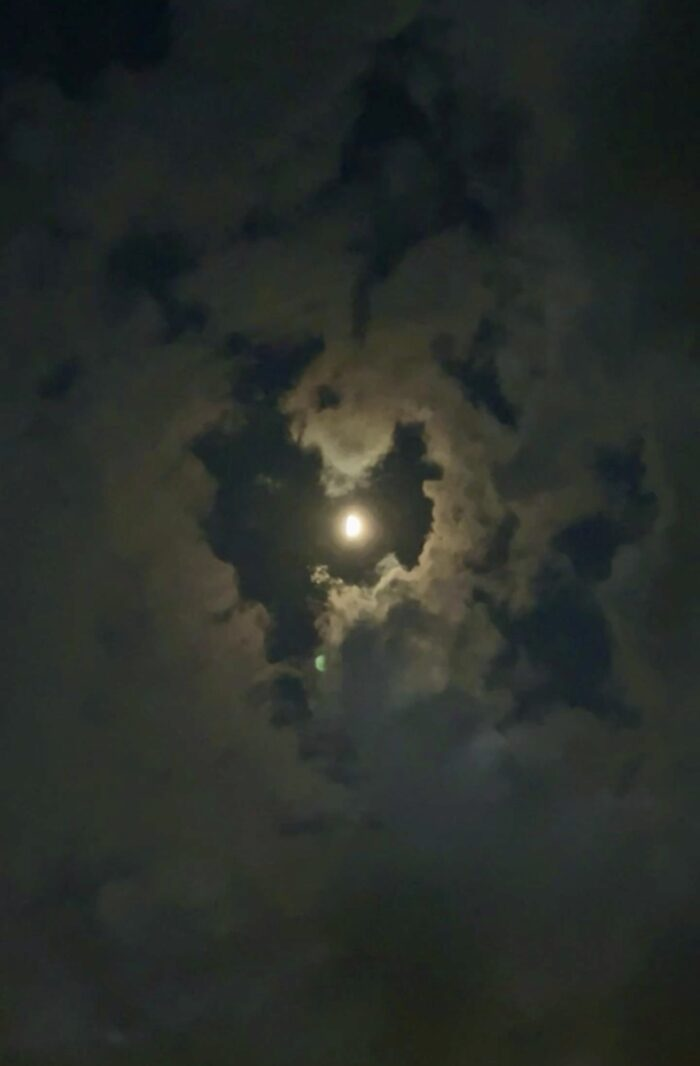 heart shaped cloud around the moon at night