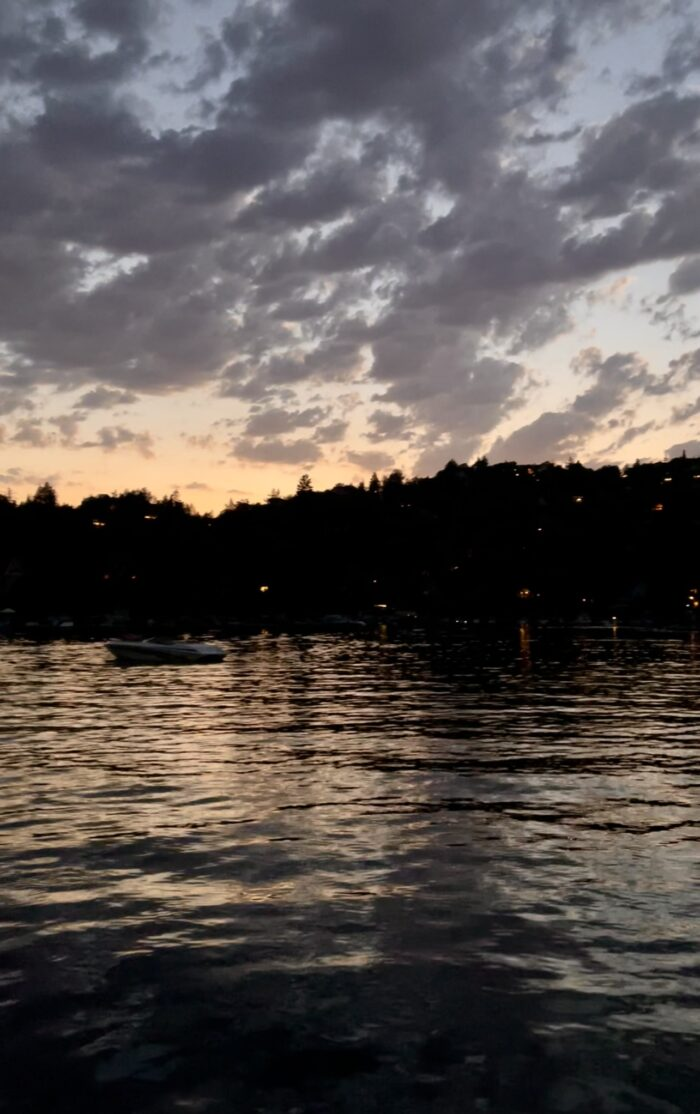 on the water at night, boats on lake arrowhead at night, light reflect on rippling water on the lake at night