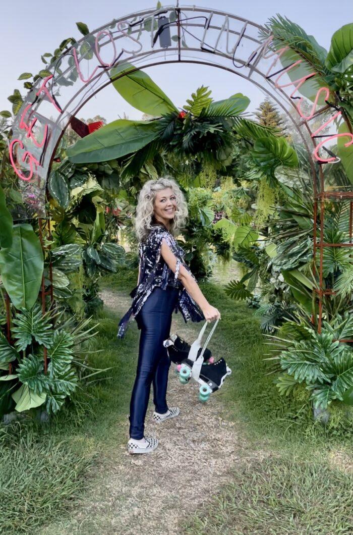 botanical archway, discoasis at the botanical gardens summer 2021, roller disco, roller skating, disco night, 70s roller disco, roller skates, light up wheels, disco oasis, roller skate disco outfits, disco fashion