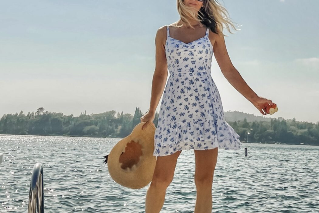 on the dock on the lake in lake arrowhead, summer, sun dress, floral sundress, white dress with blue flowers, dresses with sneakers, dresses with tennis shoes, blue, seascap, love maegan