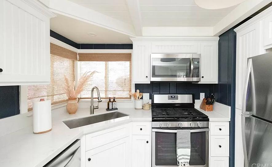 all white kitchen with dark paneled backsplash walls, contemporary mountain house in lake arrowhead