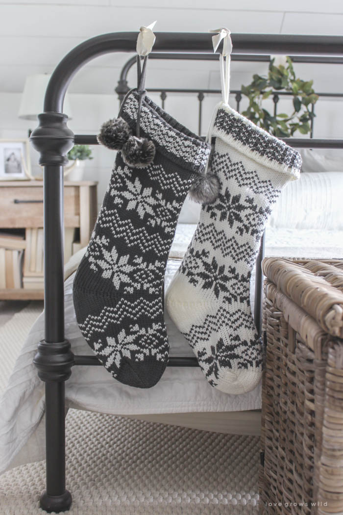 christmas stockings hanging from the bed