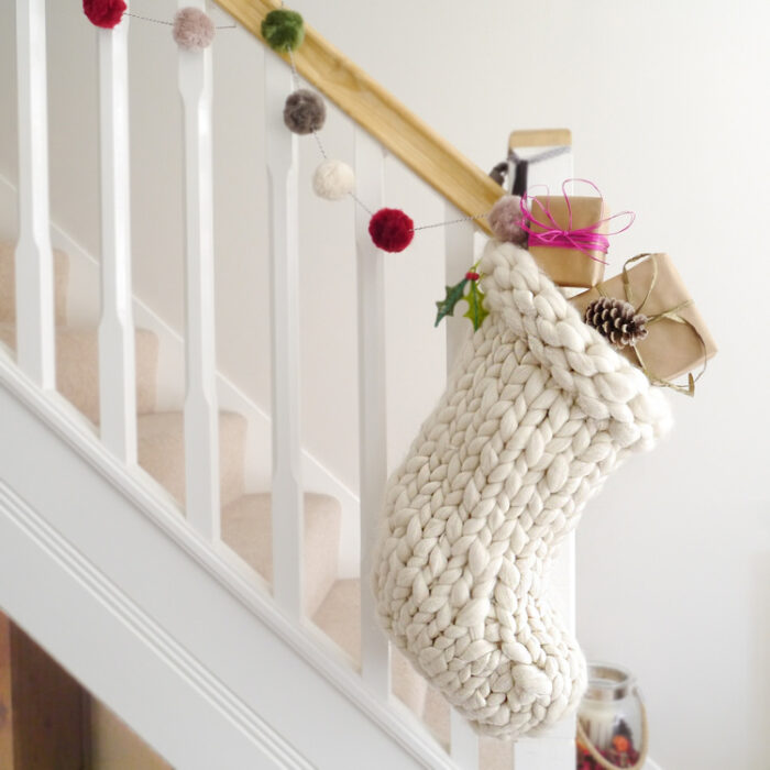 knit christmas stocking hanging from the banister