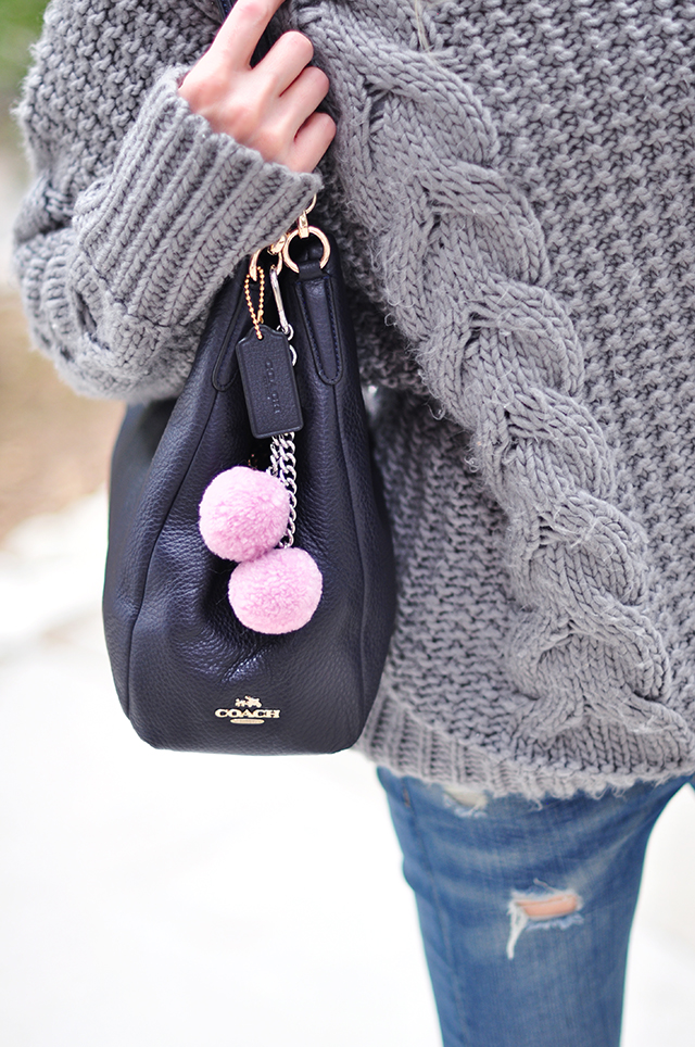 Coach bag_Pink poms_bag charms_gray sweater_jeans