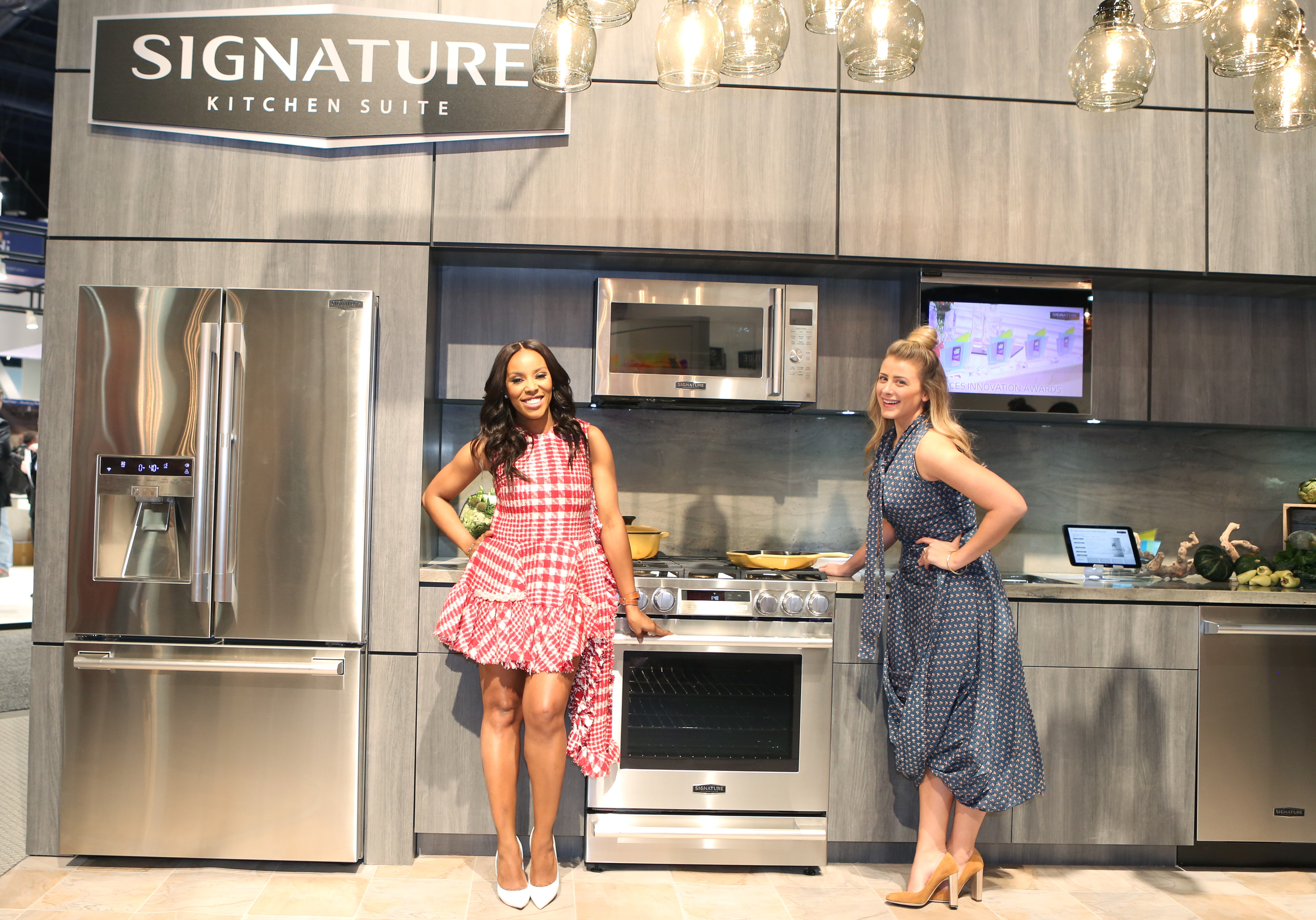 Fashion stylist June Ambrose, left, and lifestyle expert Lo Bosworth  celebrate the launch of Signature Kitchen Suite at the Kitchen and Bath Industry Show in Las Vegas on January 19, 2016, at Las Vegas Convention Center. (Photo by Bizuayehu Tesfaye/AP Images for Signature Kitchen Suite)