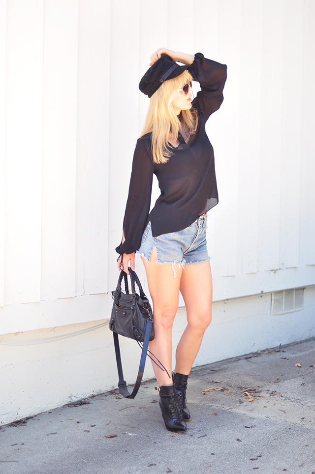 LA Style_ Cutoffs+Black Blouse+Black Boots+Hat+Balenciaga bag
