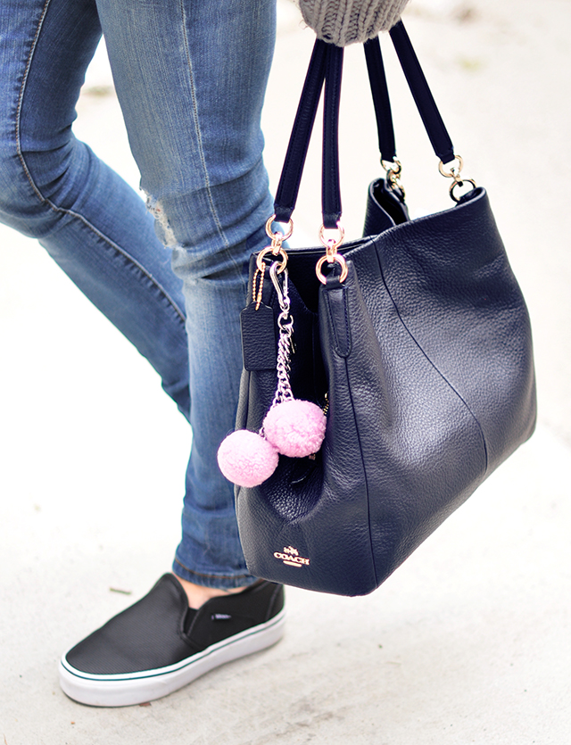 Navy coach bag with pink poms