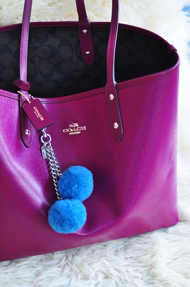 Reversible Coach tote bag with pom pom charm