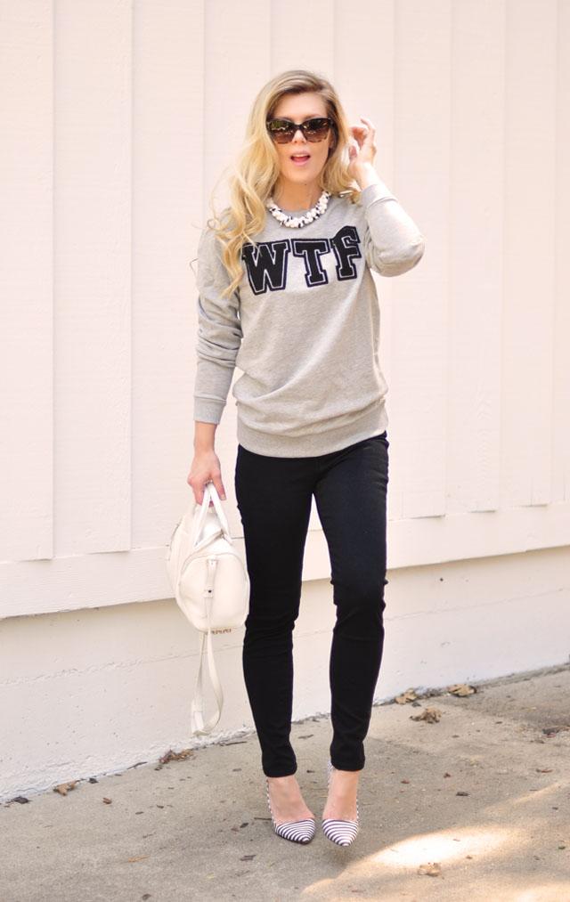 WTF sweatshirt and black jeans