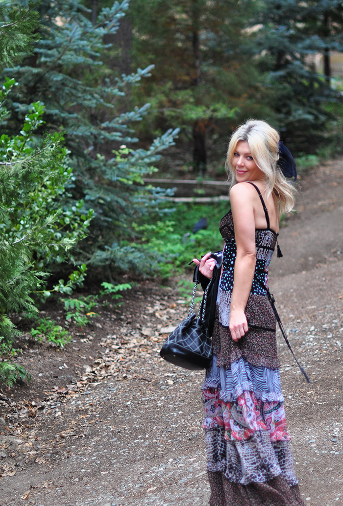 tiered max dress with floral embroidered leather jacket and chanel bag