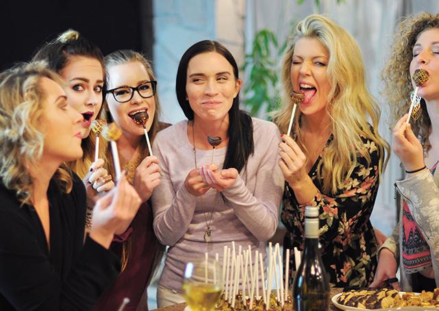biting-into-cake-pops_friendsgiving-dinner