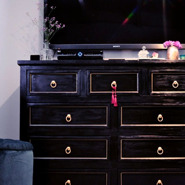black and gold dresser