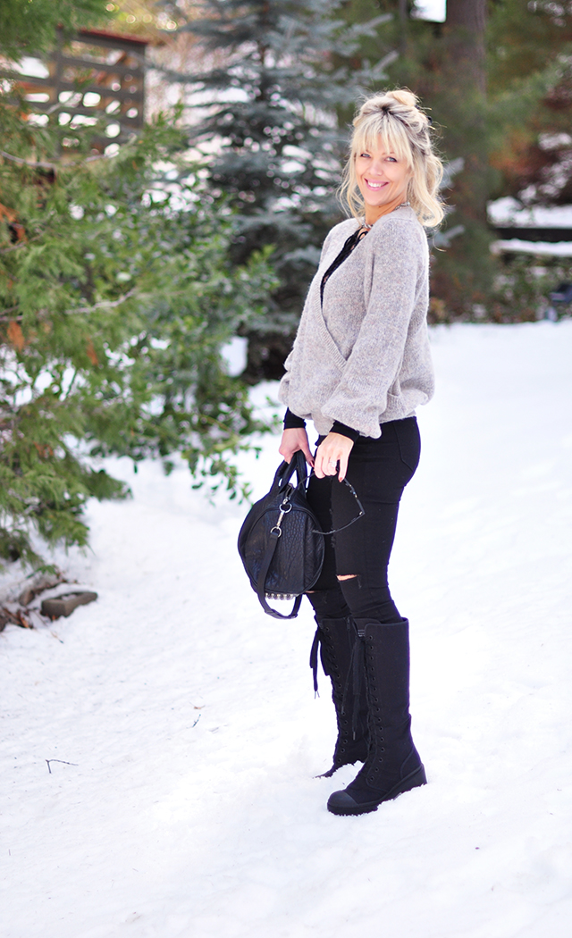 black and gray outfit in the snow