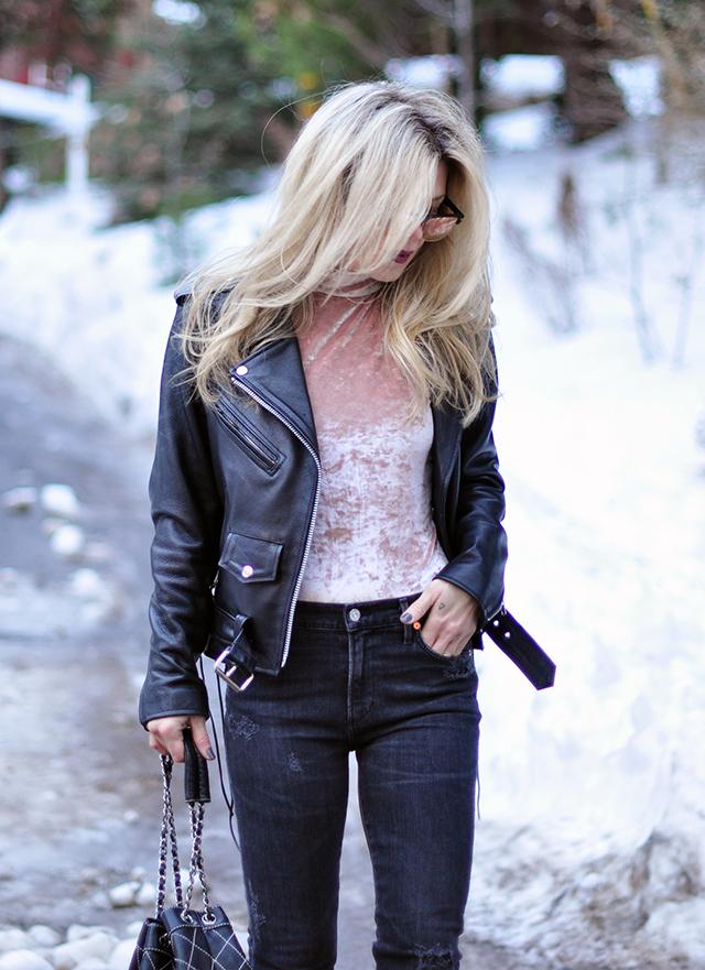 pink crushed velvet bodysuit, distressed denim, biker jacket, in the snow