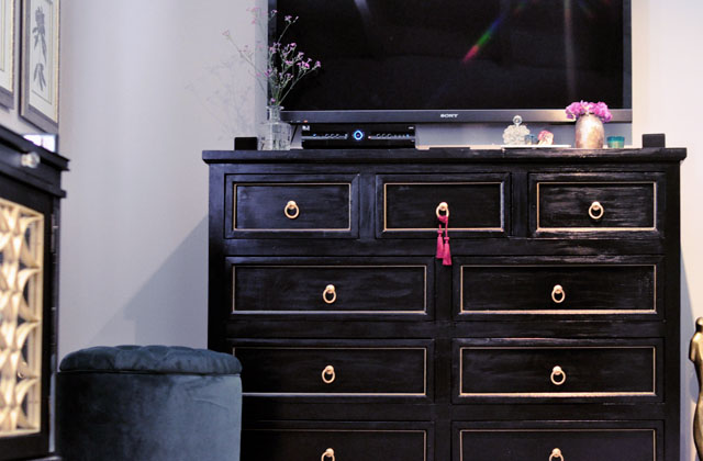black dresser with gold pulls    accents