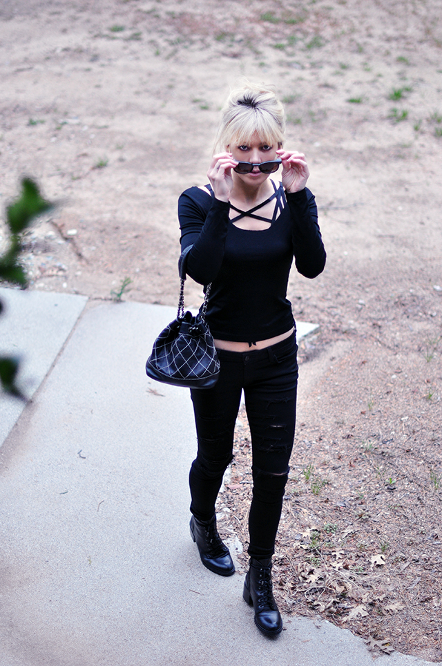 black outfit _ ripped skinny jeans _layering harness bra top