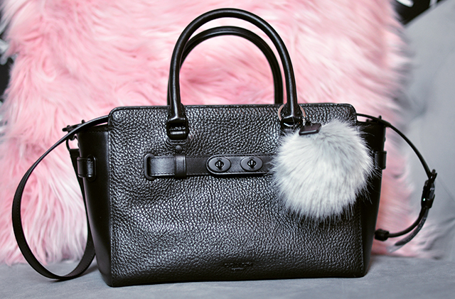 black-pebbled-leather-coach-bag-with-fur-charm