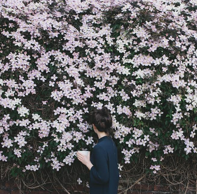 Girl with coffee and flowers