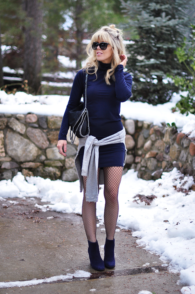 bodycon navy dress and boots with fishnets in the snow