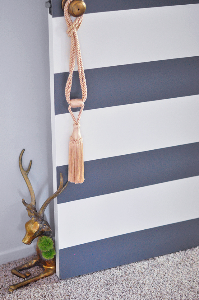 bold striped door _ brass statue door stop