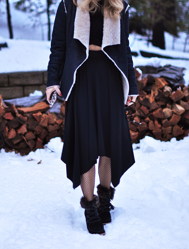 cut out dress with fishnets in the snow