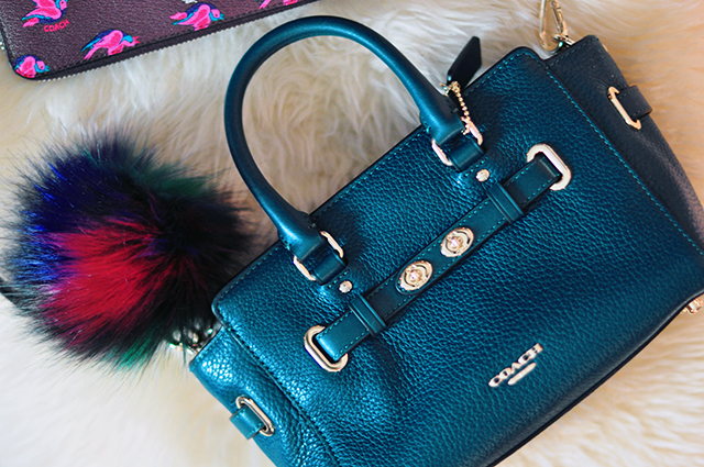 deep-teal-coach-bag-with-fur-bag-charm