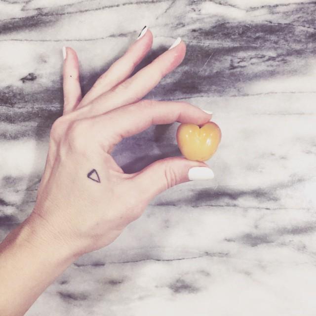 heart shaped cherry_small hand tattoo