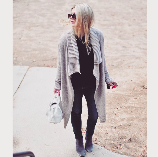 jeans and boots and oversized sweater