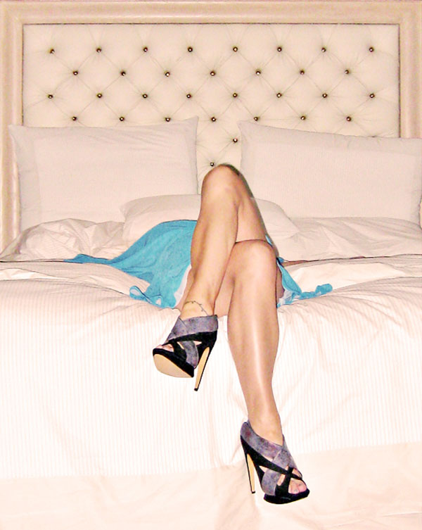legs crossed on bed-tufted headboard-kirkwood shoes
