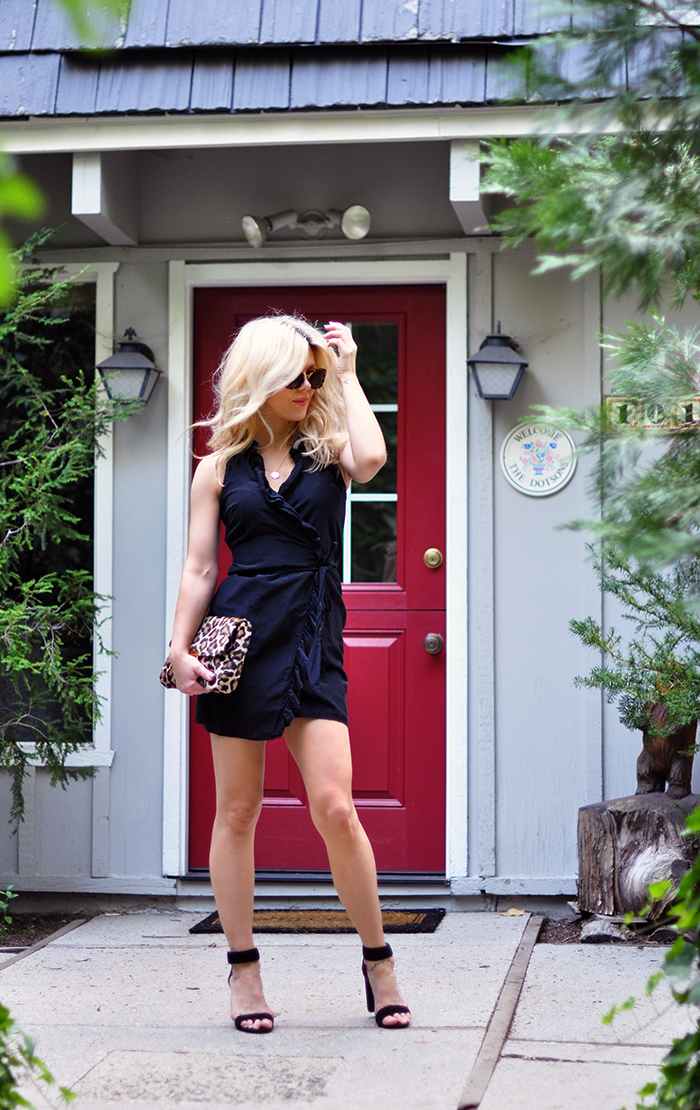 little black wrap dress with ruffle - leopard bag