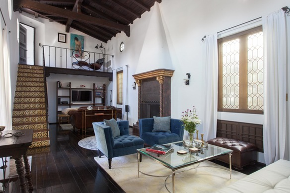 living space with open stairs spanish style