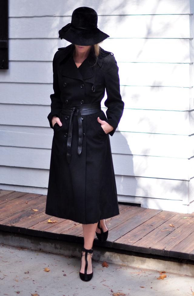 long black trench coat - black hat- black shoes