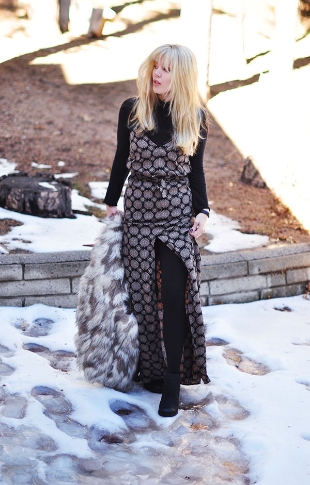 maxi dress with a turtleneck and tights in the snow
