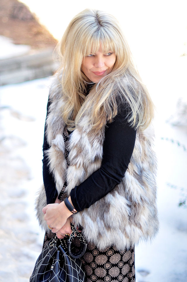 maxi-dress-with-faux-fur-vest-in-the-snow