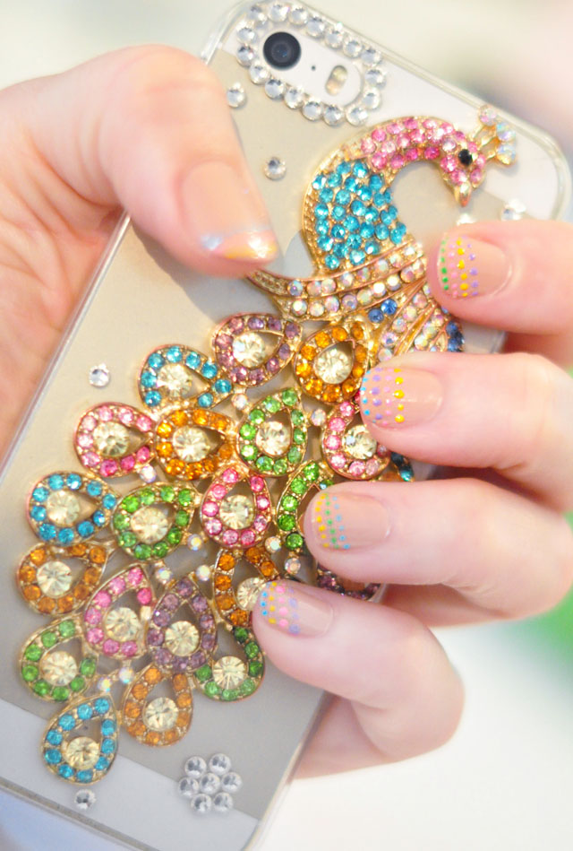 nude nails with rainbow dots-peacock rhinestone iphone case