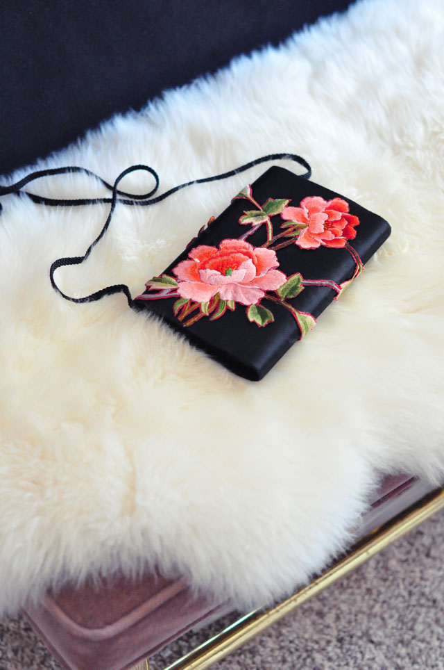 rose embroidered satin clutch bag