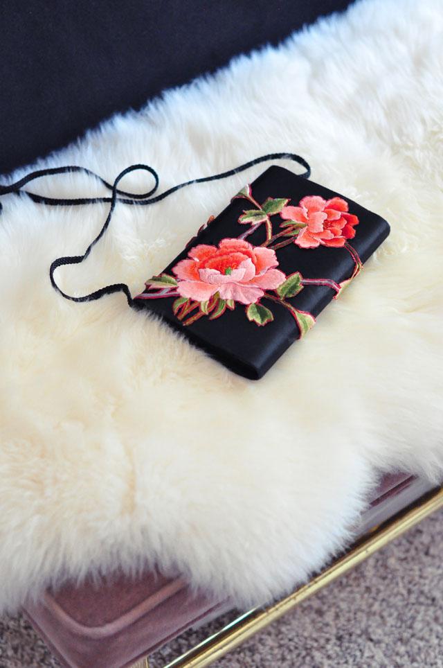 rose embroidered satin clutch bag