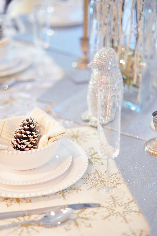 silver and gold holiday table_penguins and pinecones